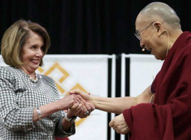 The Dalai Lama and Democrat Nancy Pelosi, Speaker of the US House of Representatives greet one another.